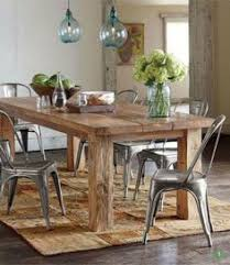 reclaimed wood table from floor boards love the texture between the table and metal chairs rustic dining