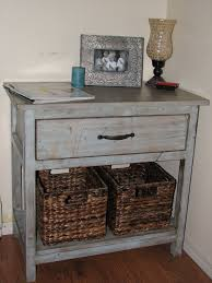 diy wood bedside table made from reclaimed wood painted with white chalk paint color with drawer and rattan basket storage for rustic bedroom spaces ideas