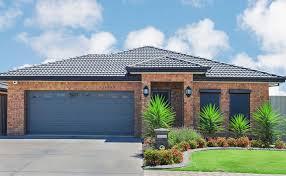 Blue garage door brick house