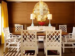 white lacquered furniture. Modern Dining Room With White Carved Back Lacquer Chairs, Wood Paneled  Walls, Round Brass Lacquered Furniture