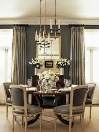 multiple small chandeliers at sgered heights over dining table great effect