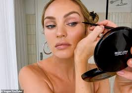 precision candice uses a fine angled brush to apply her brown pencil eyeliner
