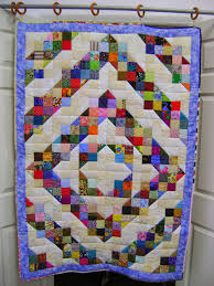 life, quilts and a cat too: party time & Look at THIS LINK from Big Horn Quilts for various log cabin sets and you  may see other possible sets for this simple but effective block. Adamdwight.com