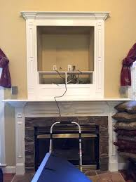 idea tv mount over fireplace for make that outdated hole above fireplace vanish by installing a flat screen covering it 55 tranquil mount fireplace pull