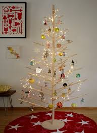 12 Modern Christmas Trees You Can Decorate With This Holiday Wooden Branch Christmas Tree