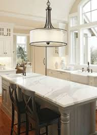 love the look of a drum shade over a kitchen island plus see great tips on hanging lights