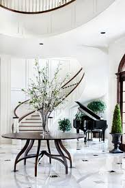 traditional round entryway table flowery vase grand piano mediteranian stairs cool flooring wide space entryway