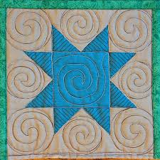 The Free Motion Quilting Project: 48. Quilt Spirals in a Sawtooth Star & free motion quilting | Leah Day free motion quilting | Leah Day Adamdwight.com