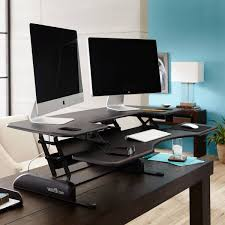 adjustable standing desk office. The VARIDESK Pro Plus 48 Is A Height-adjustable Standing Desk Designed With Spacious Adjustable Office S