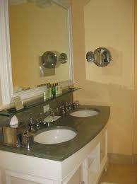the breakers bathroom with granite countertops embedded tv in mirror