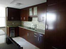 resurface or refacing dark laminate kitchen cabinet with glass tile backsplash and frosted door wall