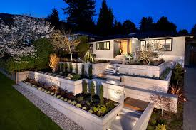 Mid-sized midcentury modern gray two-story concrete exterior home idea in  Vancouver