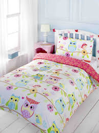 Girls Owl themed bedding, great idea for toddlers or tweens. Comes in a  single, double or cot bed size. White background with rows of Brightly  coloured owls ...