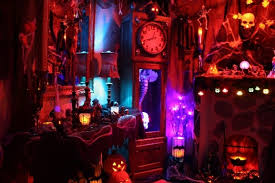The clock and the fireplace are props but everything around and behind them  are the backdrop camo nets covered with Halloween crap. LOL