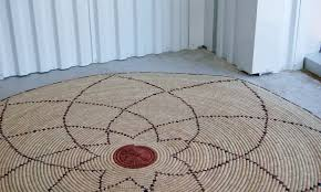 round natural fiber accent rug spirograph pattern
