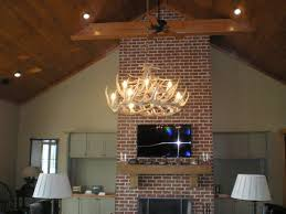 1x4 board ceiling treatment cathedral ceiling cherokee brick fireplace flat screen tv mounted