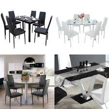 table with chairs. glass dining table set with 4 or 6 faux leather rib chairs white black g