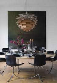amazing dining room with danish design clics by poul kjaerholm and georg jensen the sculptural ph artichoke l from louis poulsen hangs over the