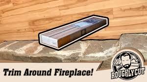 cut laminate flooring against uneven fireplace