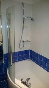 photographs re tiling bathroom shower walls