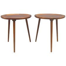 pair of walnut three legged round side tables anton kildeberg danish modern for