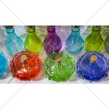 set of small colorful transpa bottles