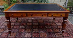 antique victorian partners library table with black writing leather top