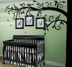 simple baby room design with large forest style tree wall decal black and white wall
