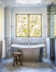 waterworks oval bathtub with gray marble tiles