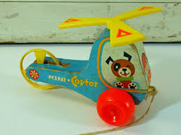 description this wooden toy helicopter