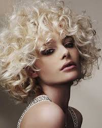 short blonde curly hairstyle with perms