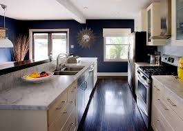 view in gallery white carrera marble cream cabinets and navy blue walls define this trendy kitchen