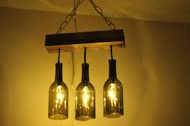 instead of investing money outside and ing lighting fixtures you can create your very own hanging pendant using the wine bottles that you have