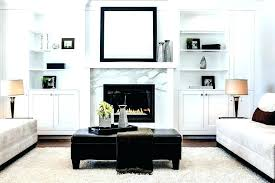 white marble fireplace surround with wooden wall mirrors living room transitional and black victorian firepla