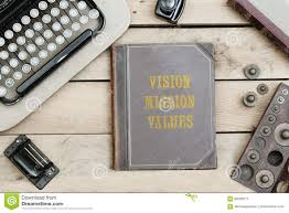 vision mission values text on cover of old book on office desk with vine type writer machine from 1920s and other obsolete office items