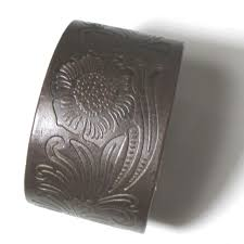 tooled in a lovely pattern a wide leather cuff bracelet