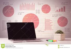 Office Pie Chart Laptop On Office Desk With Sales Pie Charts Stock Image