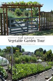 a real life raised bed vegetable garden tour that shows how easy raised bed gardens are