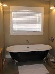 clawfoot tub with jets bathroom black claw foot bath used cast iron bridlington vintage designer burnished