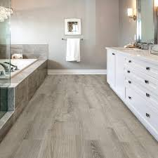 append a stylish look to your home by choosing this durable allure isocore wide smoked oak silver luxury vinyl plank flooring