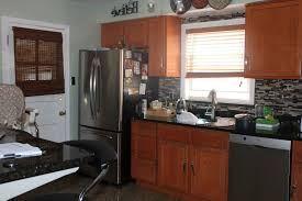 yellow u shape kitchen cabinet white single bowl sink stainless slate appliances gains popularity