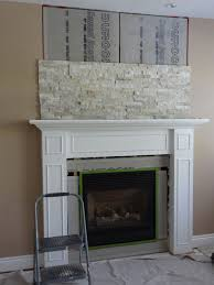 Outstanding Stacked Stone Fireplace With White Mantle Images Inspiration