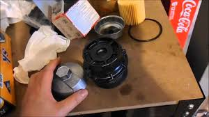 2009 (10th generation) Toyota Corolla oil filter housing and oil ...
