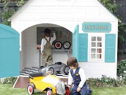 start tinkering with those mini ride ons in hip kids jack s wooden cubby house 1 099 which makes a great garage fire station or work