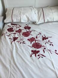 white double bedding set with red fl design duvet cover and matching pillowslips