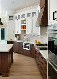 natural wood floors with white cabinets cabinets transitional kitchen and dark stained wood glass upper cabinets