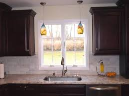 over sink kitchen lighting. kitchen lighting over the sink light abstract iron mid century modern glass green backsplash flooring countertops