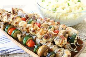 Greek Chicken Souvlaki With Lemon Rice Butter With A Side Of Bread
