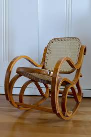 a vintage bentwood child s rocking chair with cane back and seat circa 1950 very