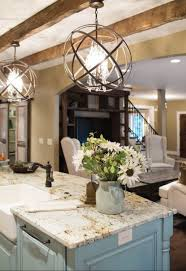 these modern chandeliers with an innovative design contributed to add a modern touch to this classic living space placed above the kitchen island